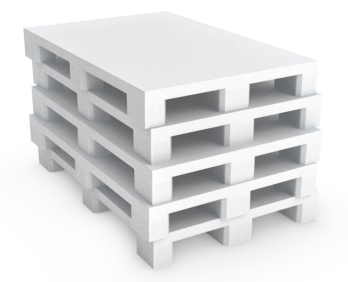 Stack of white plastic pallets - plastic packaging exampel